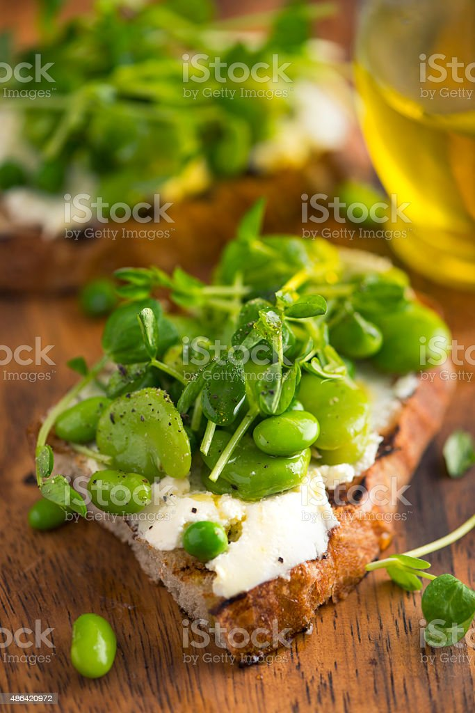 Bruschetta with Cream Cheese, Beans and Pea Sprout stock photo