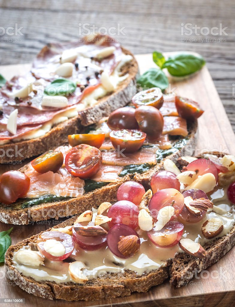 Bruschetta with different toppings stock photo