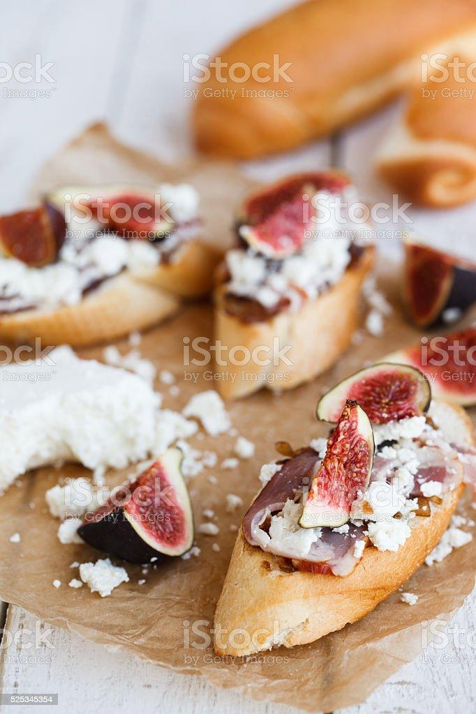 Bruschetta with figs,cheese stock photo
