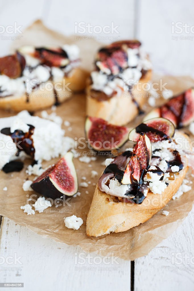 Bruschetta with figs,cheese stock photo