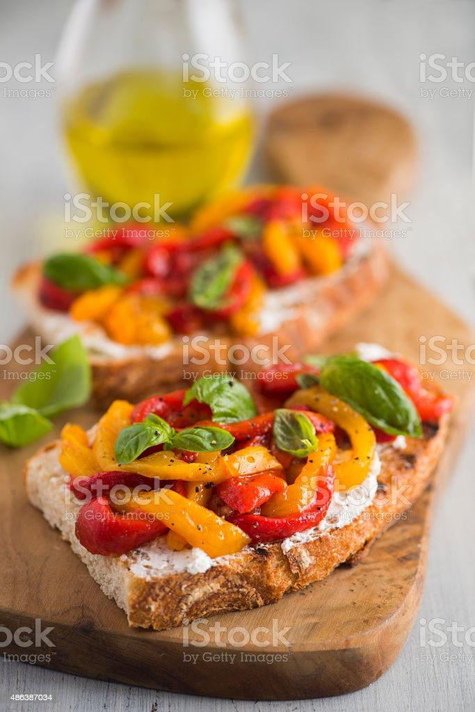 Bruschetta with Goat Cheese and Roasted Bell Peppers stock photo