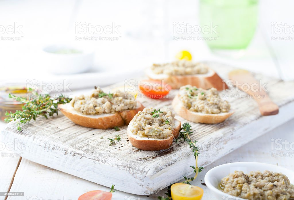Bruschetta with green olives paste, tapenade on a white background stock photo