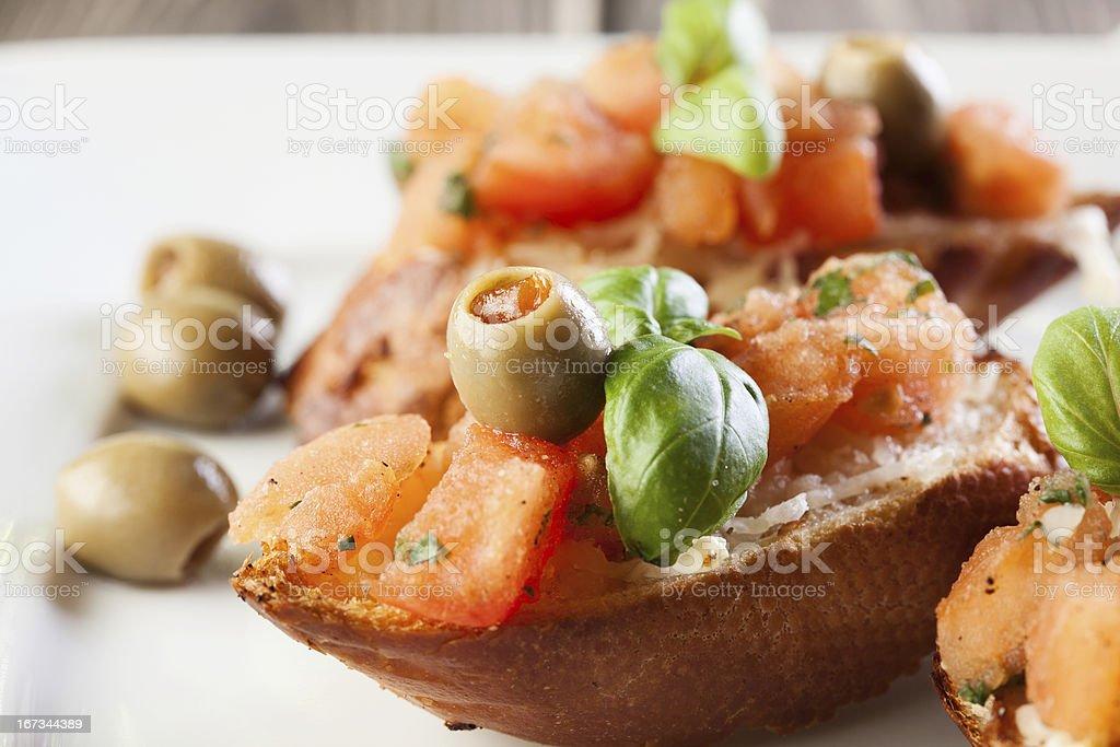 Bruschetta with mozzarella and tomato royalty-free stock photo