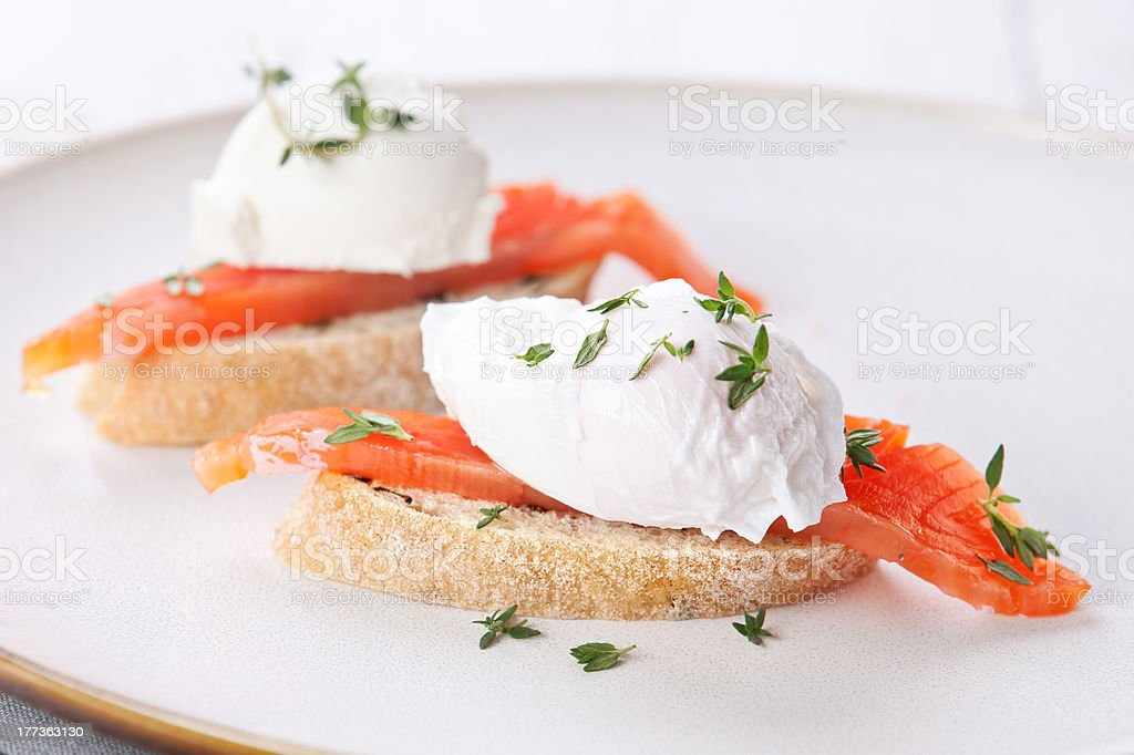 Bruschetta with poached egg and salmon royalty-free stock photo
