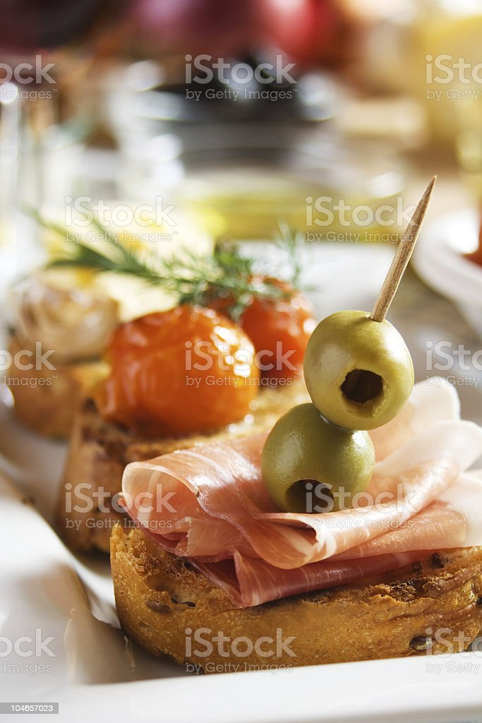 Bruschetta with prosciutto and olives royalty-free stock photo