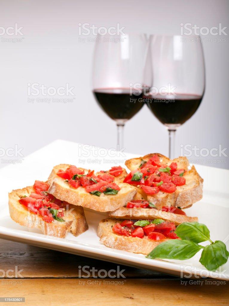 Bruschetta with red wine royalty-free stock photo