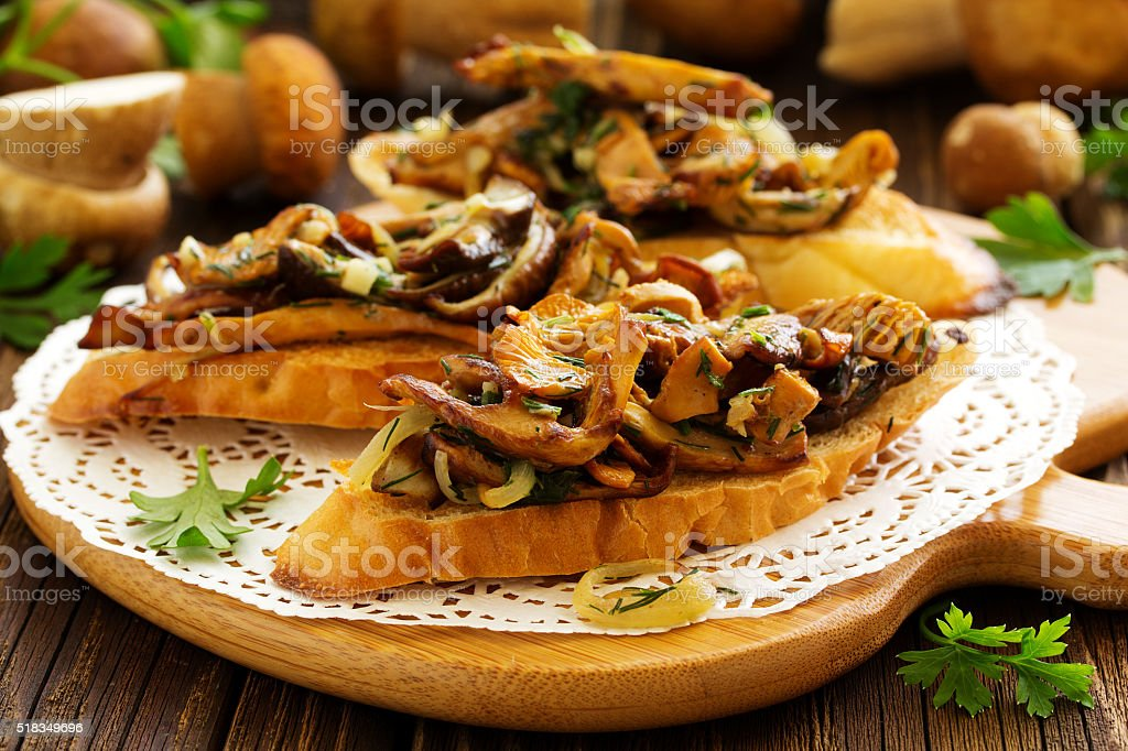 Bruschetta with roasted wild mushrooms. stock photo