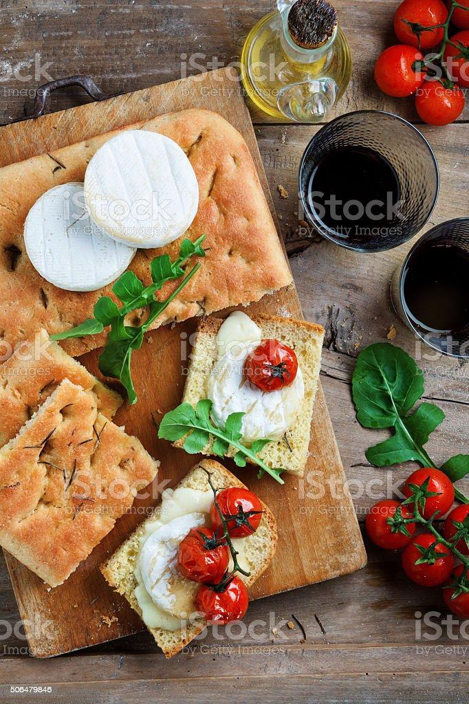 Bruschetta with stewed tomatoes and cheese Tomino.  Italian heal stock photo