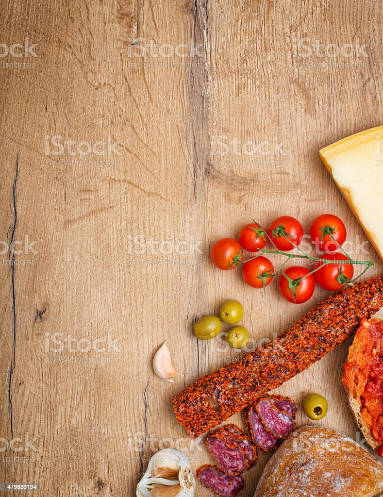 Bruschetta with tomato paste, tomatoes, cheese, olives, garlic and fuet. stock photo