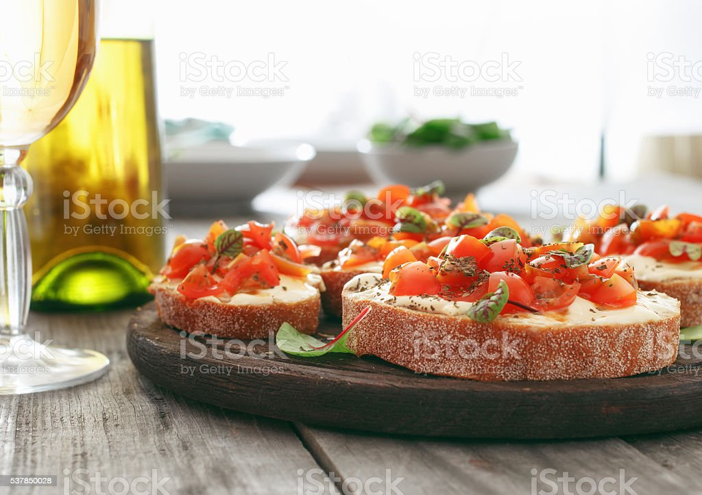 Bruschetta with tomatoes, goat cheese and basil stock photo