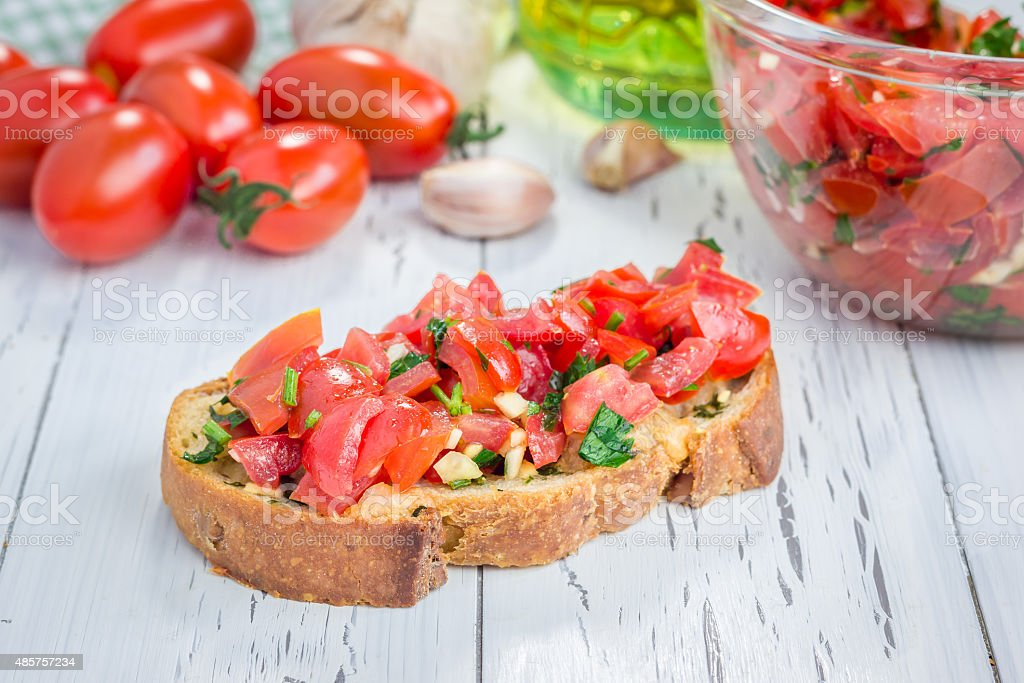 Bruschetta with tomatoes, herbs and oil on toasted bread stock photo