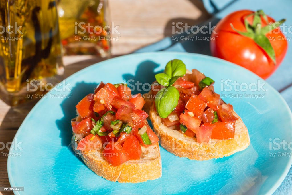 Bruschetta with tomatoes on a wooden board stock photo