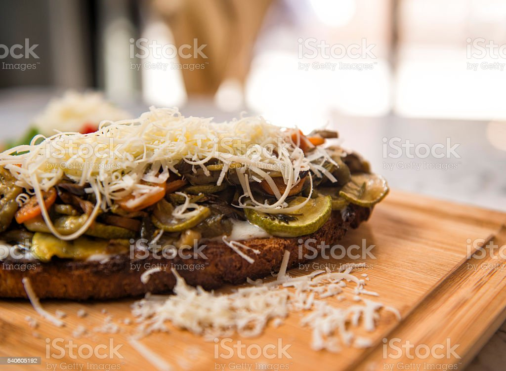 Bruschetta with vegetables and parmesan cheese stock photo
