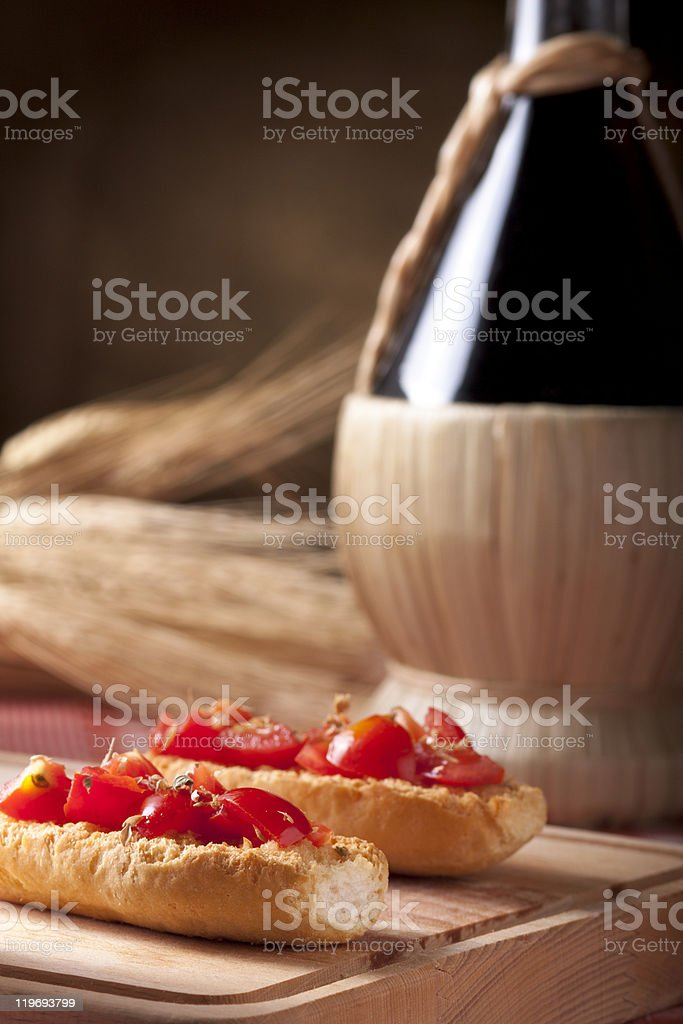 Bruschetta with Wine Flask royalty-free stock photo