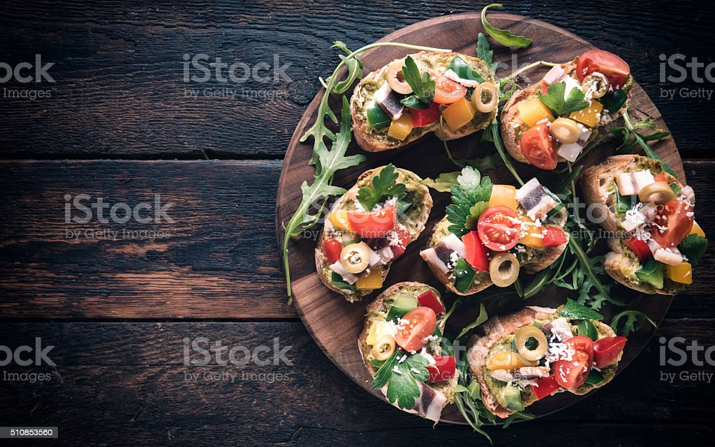 Bruschettas served on the table stock photo