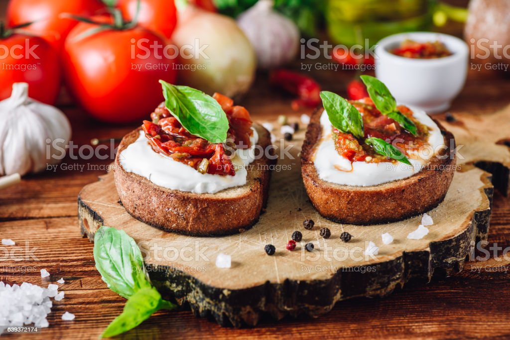 Bruschettas with Dried Tomatoes and Spicy Sauce stock photo