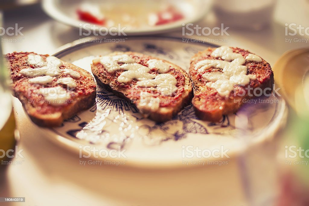 Bruschette of Pizza on the table royalty-free stock photo