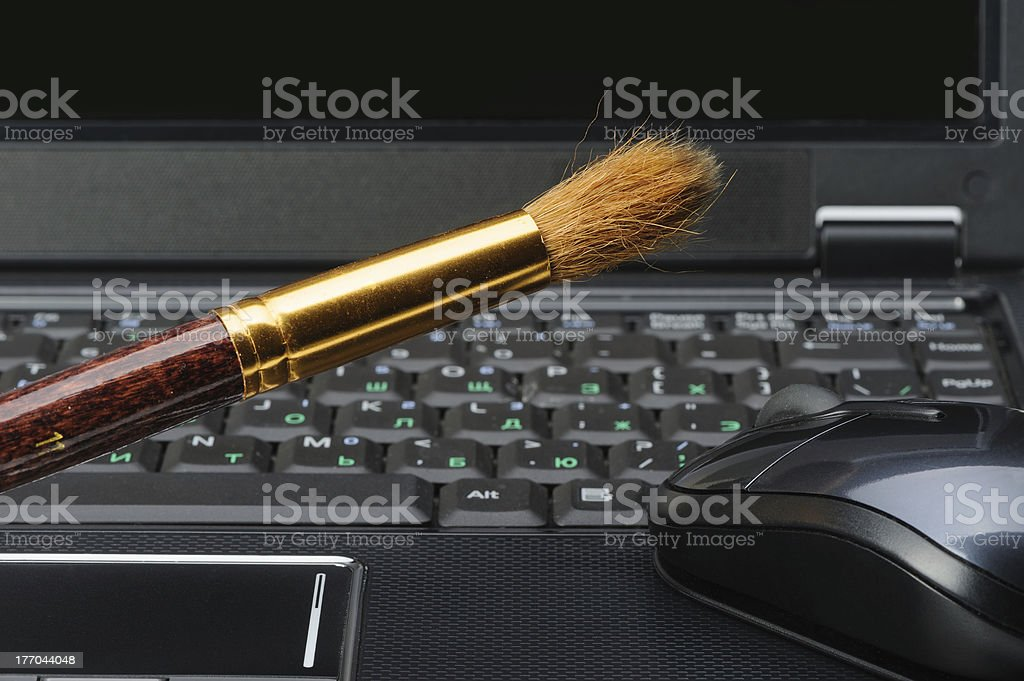 Brush and a laptop royalty-free stock photo