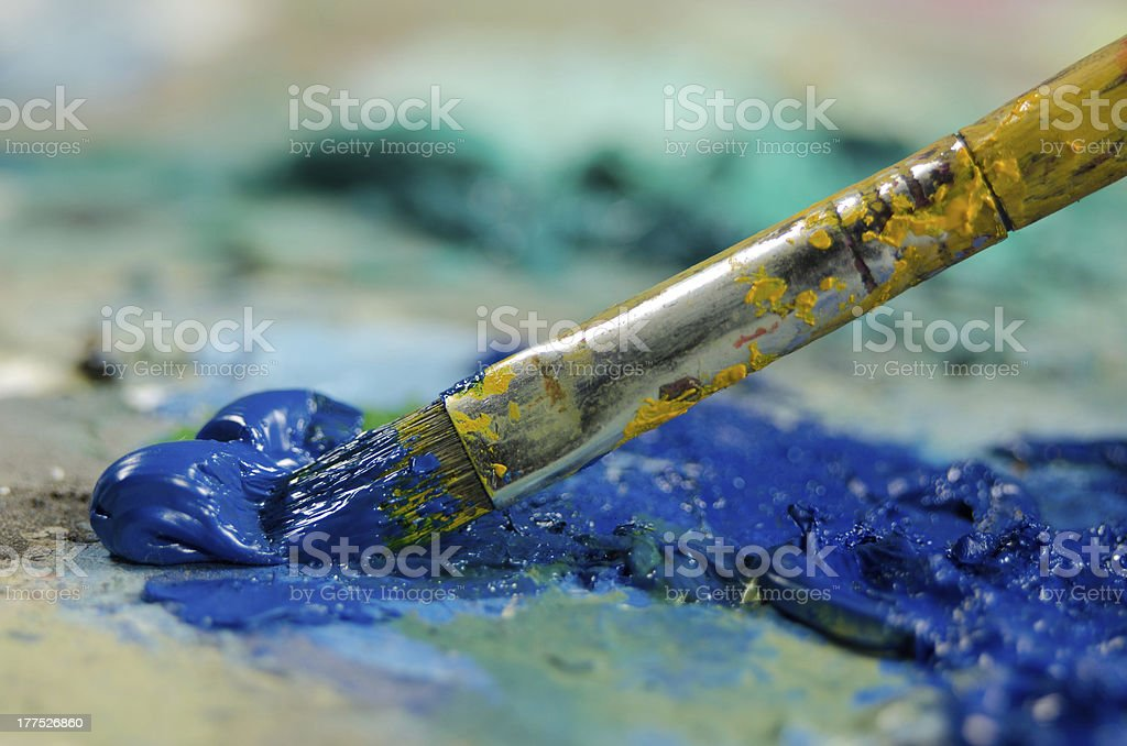 Brush and blue oil paint royalty-free stock photo