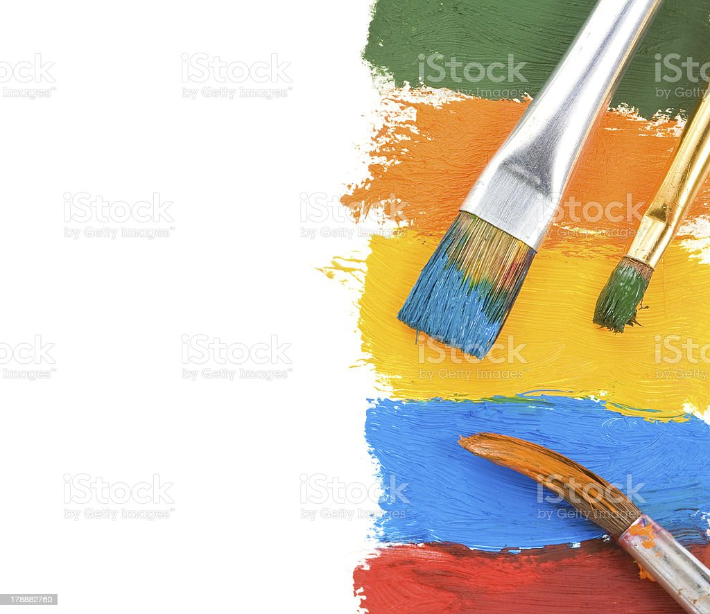 brush and color paints on white royalty-free stock photo
