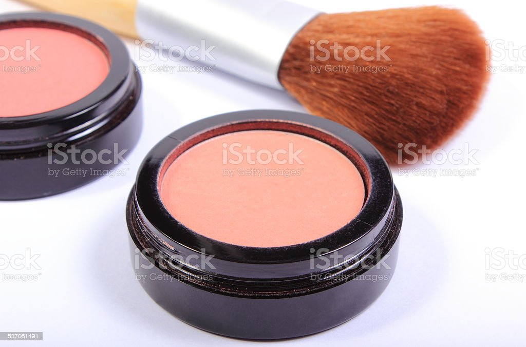 Brush and cosmetics for makeup stock photo