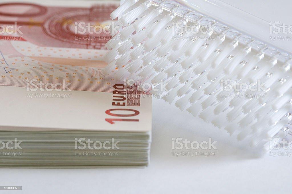 Brush and money (euros) stock photo