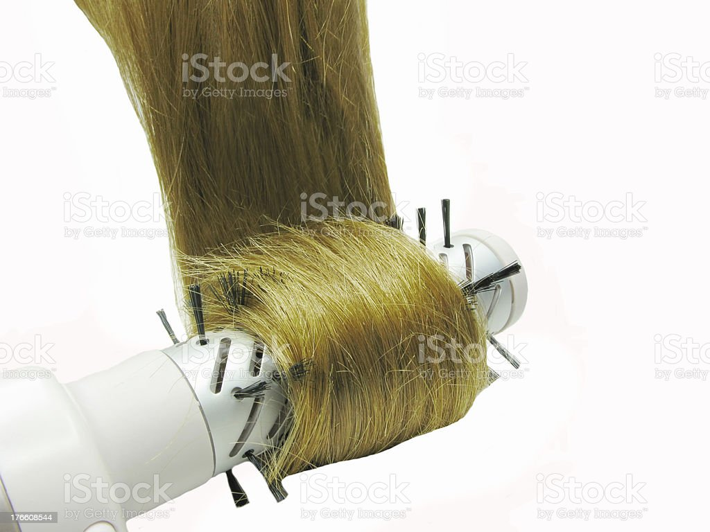 brush dryer with dark shiny hair in it royalty-free stock photo