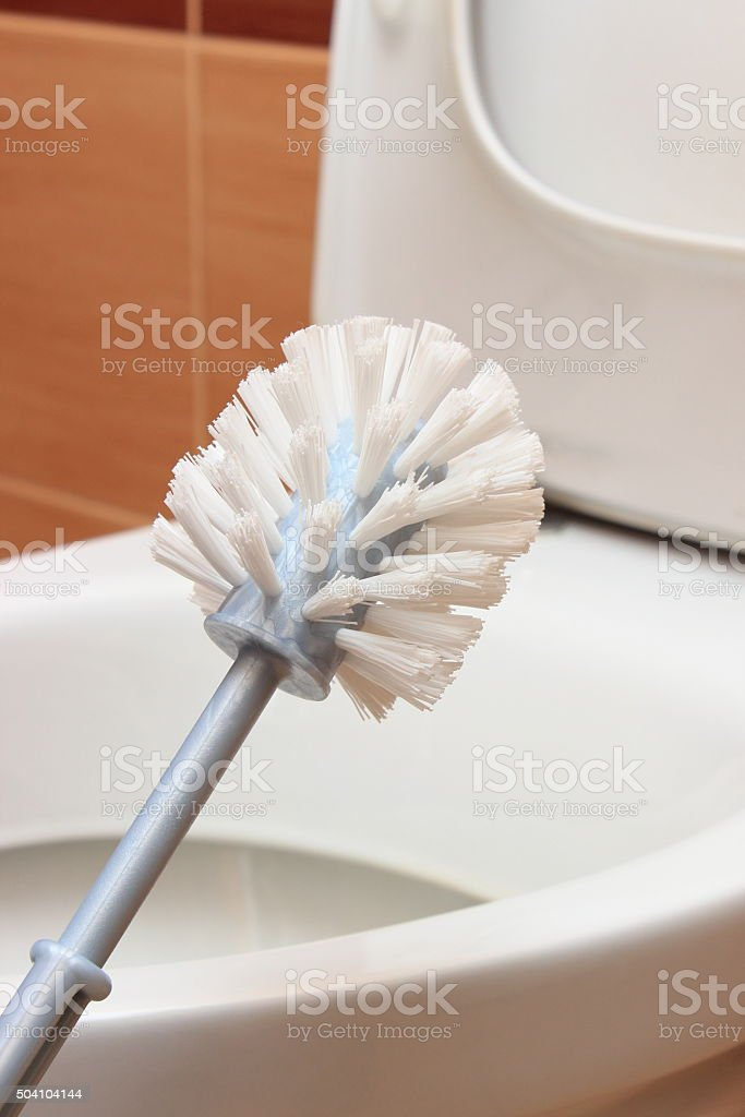Brush for cleaning and toilet bowl stock photo