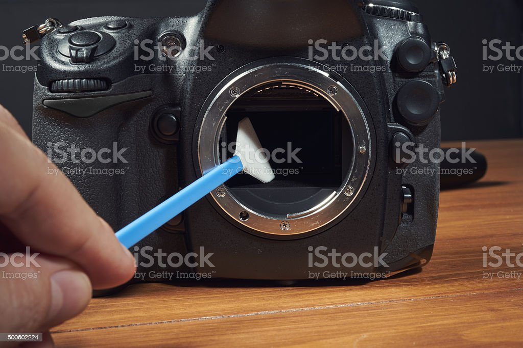 Brush for cleaning digital camera with hand stock photo