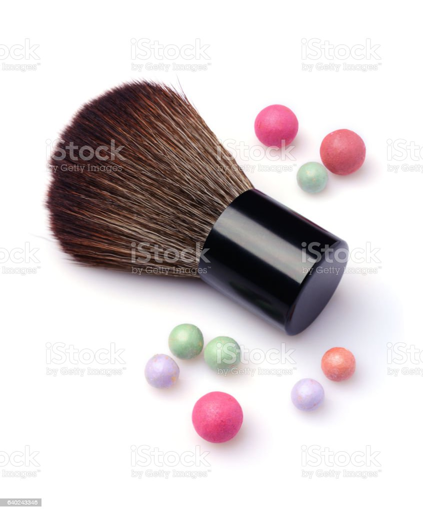 Brush for make up and multicoloured corrector face powder balls stock photo