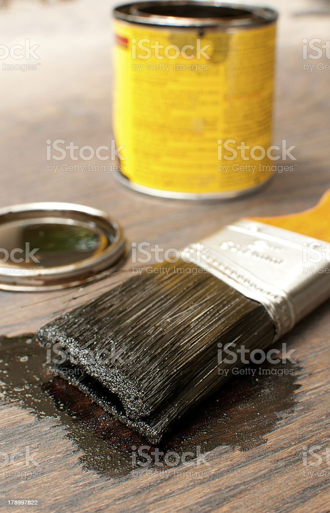 Brush for painting wood in dark royalty-free stock photo