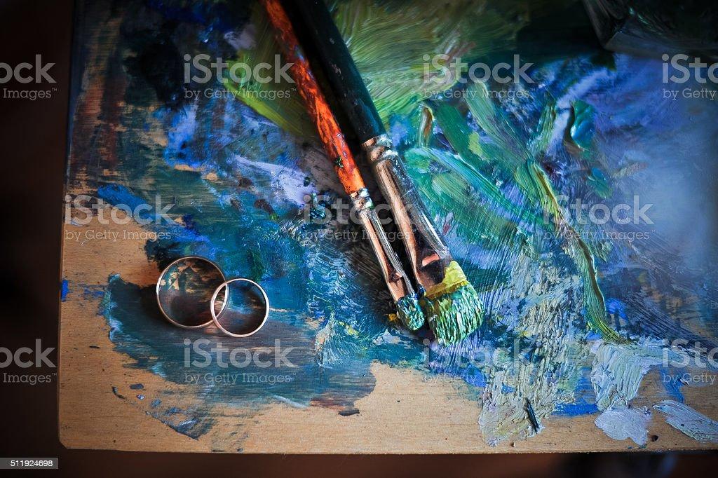 brush, ink , wedding rings stock photo