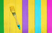 Brush on green, yellow, blue, purple and rose planks