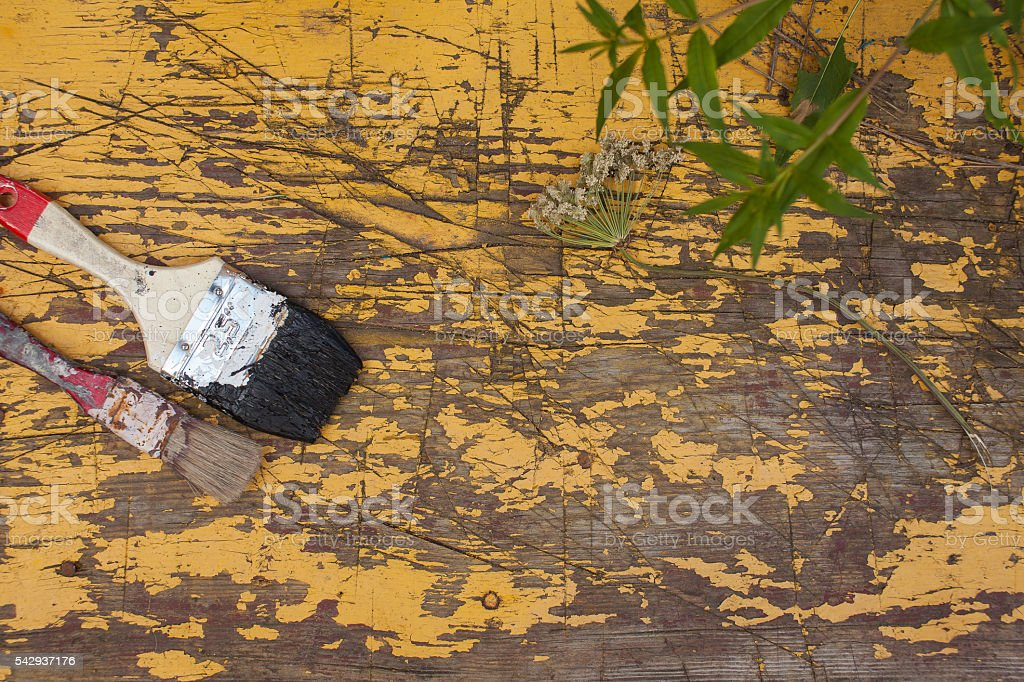 brush on the old board stock photo