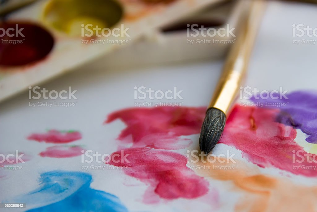 Brush on the paper with drawing closeup. stock photo