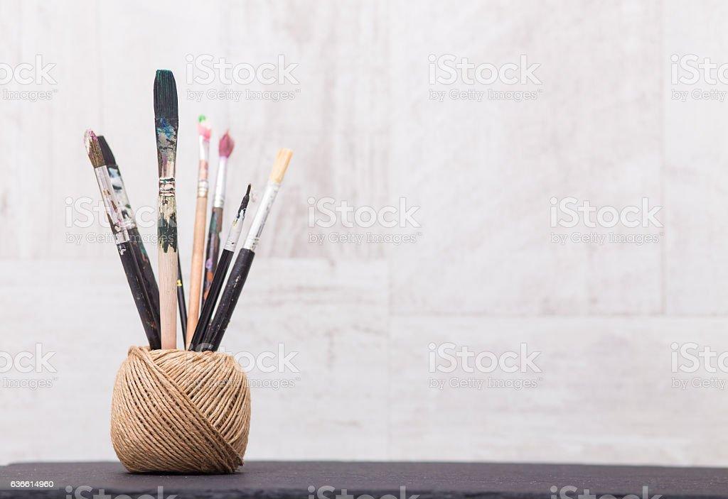 Brush paint on wooden background stock photo