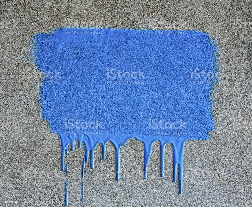 Brush strokes and paint drips on the concrete wall stock photo