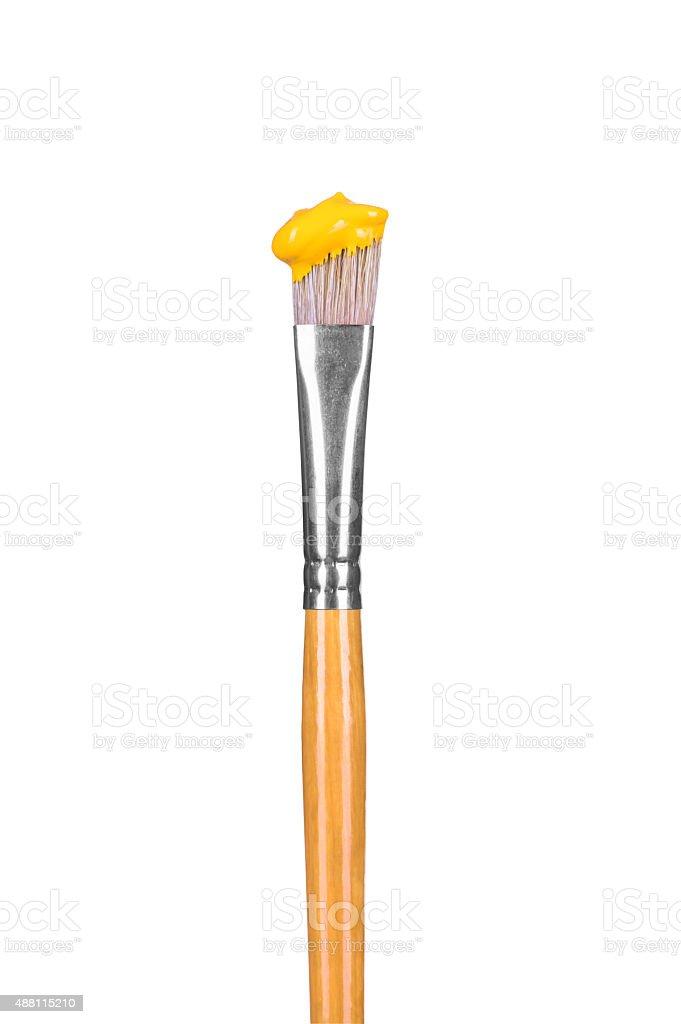 brush with yellow paint stock photo