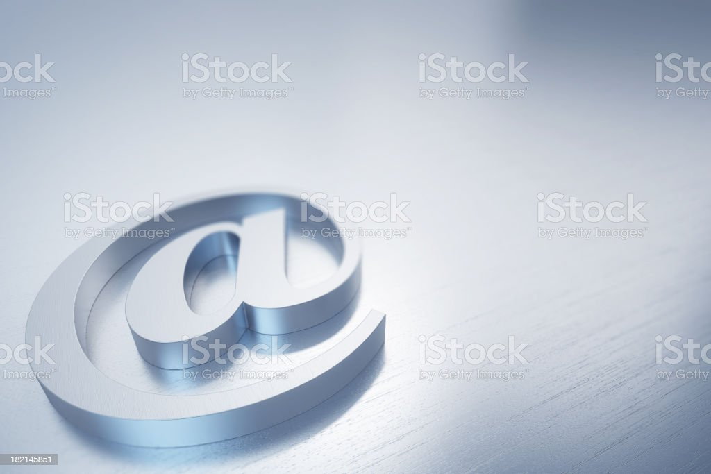Brushed aluminium @ sign stock photo