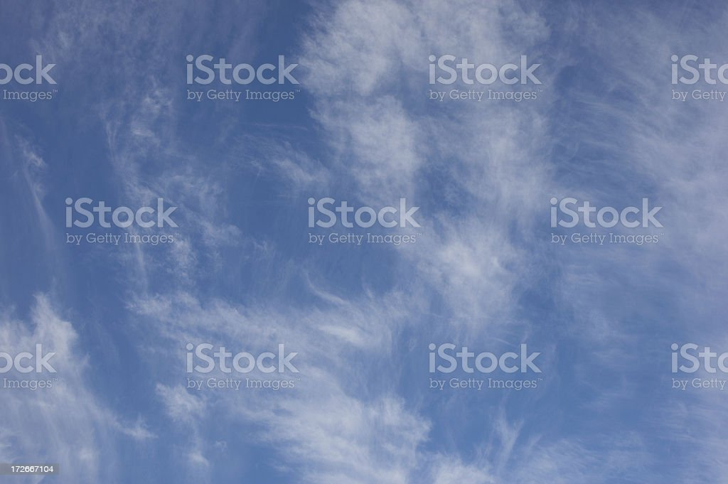 Brushed cirrus clouds against blue sky landscape A royalty-free stock photo