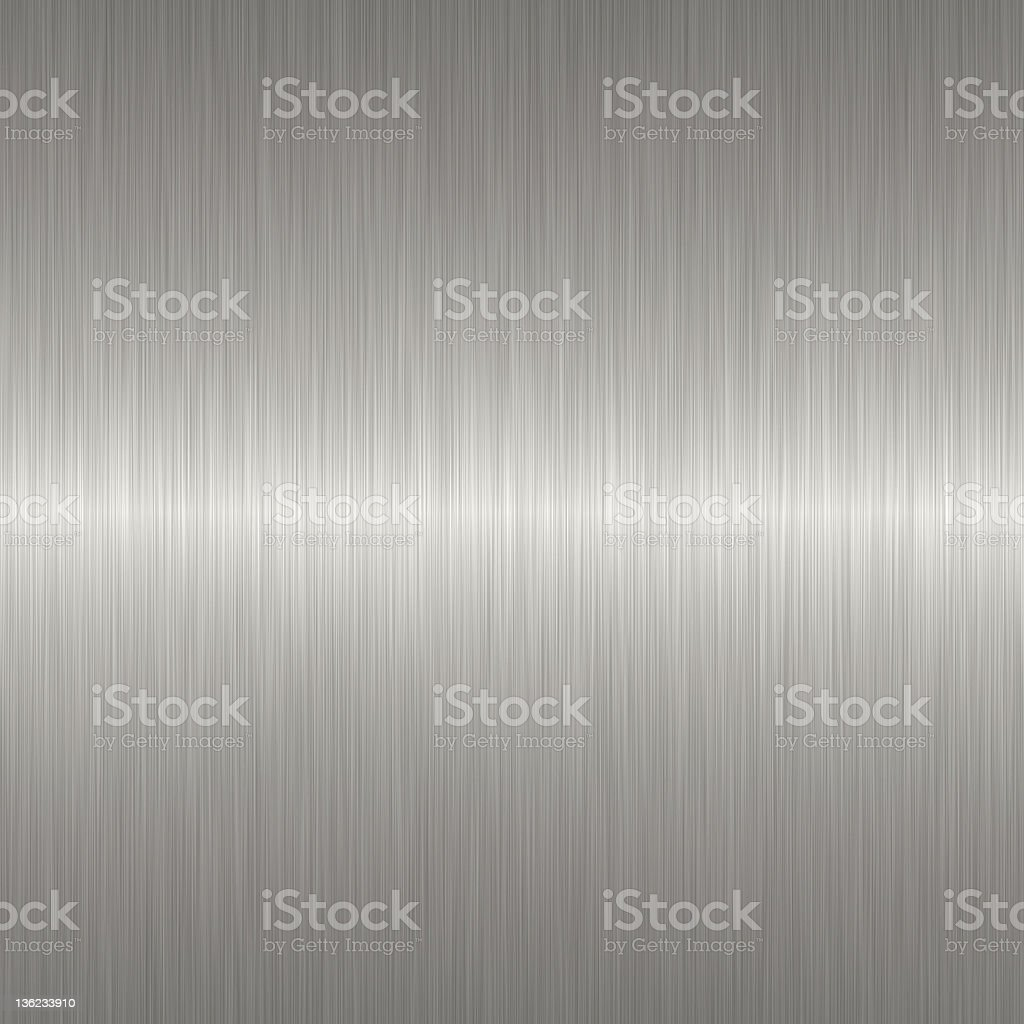 Brushed metal background with light shining at the center stock photo