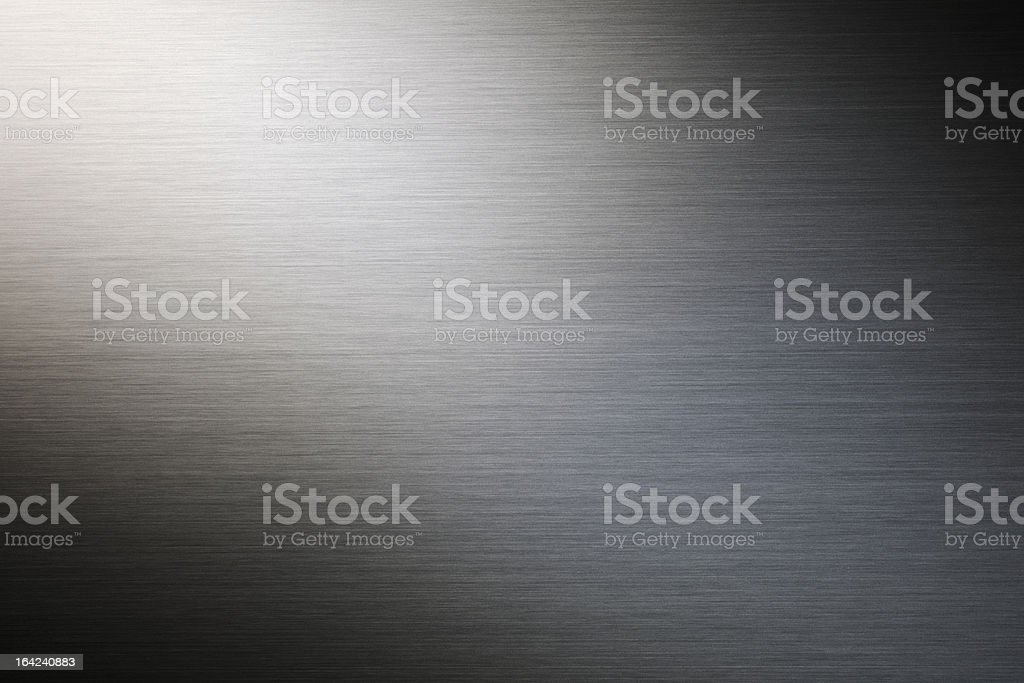 Brushed metal texture background with light rays royalty-free stock photo