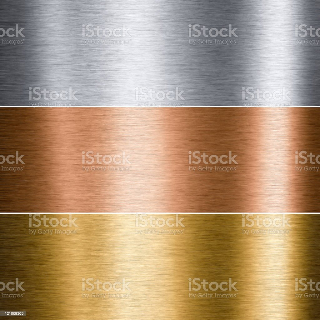 Brushed metallic plates in three colors stock photo