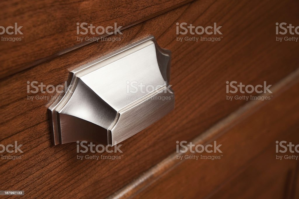 Brushed Stainless Kitchen Cabinet Drawer Handle stock photo