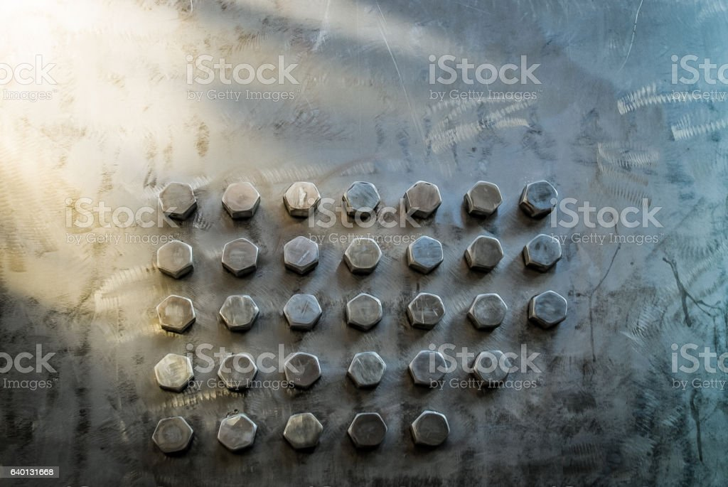 Brushed Steel Background with Bolts stock photo