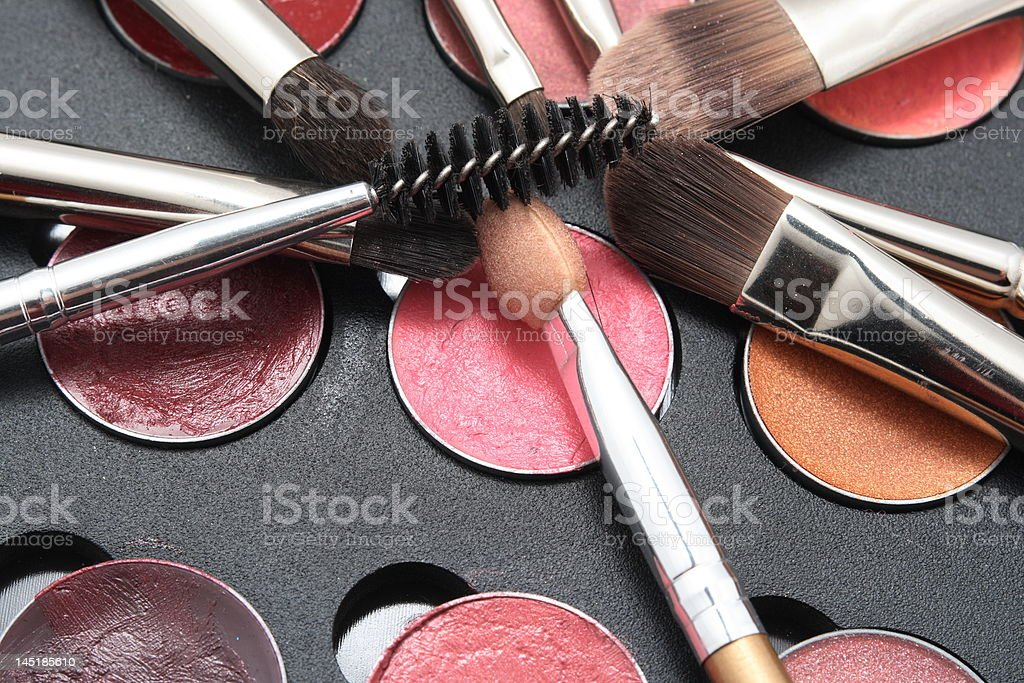 Brushes and mascara on black palette royalty-free stock photo