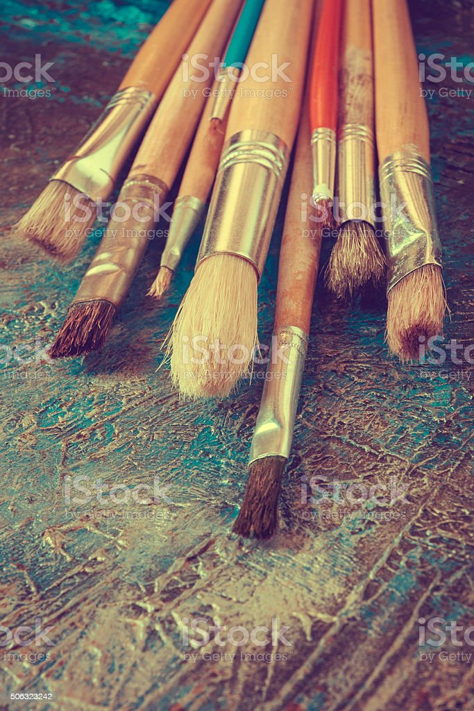 Brushes and palette with paints stock photo