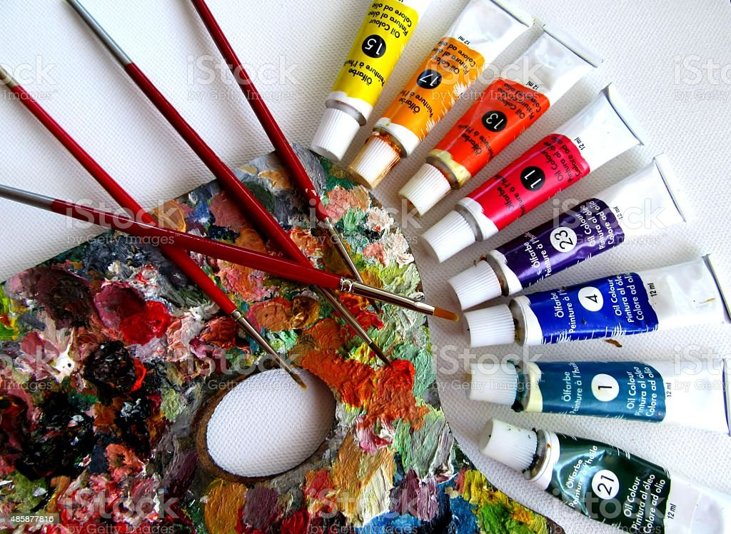 brushes, canvas and oil paints stock photo