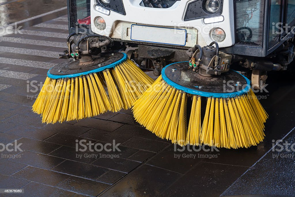 Brushes of street sweeper stock photo