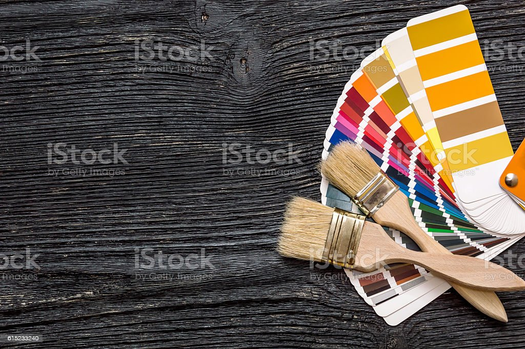 Brushes on a color swatches book stock photo